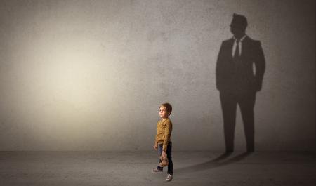 Little boy with businessman shadow