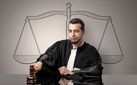 Young judge in gown deciding