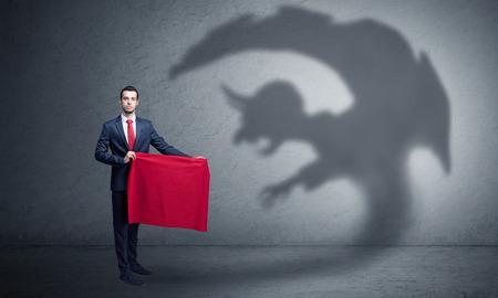 Businessman with imp shadow and toreador concept