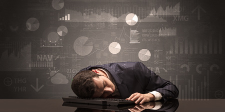 Businessman sleeping with charts, graphs and reports concept Imagens
