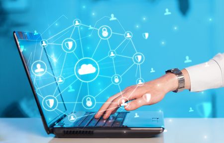 Hand using laptop with centralized linked cloud system concept Stock Photo