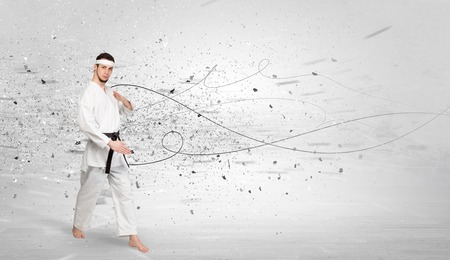 Karate man doing karate tricks with chaotic concept Archivio Fotografico
