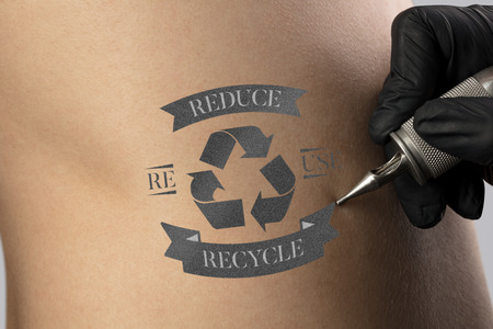 Hand tattooing recycle for a better environment concept on naked clear skin Reklamní fotografie