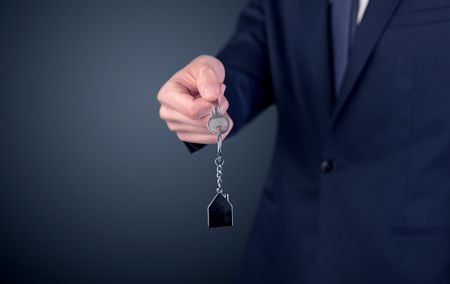 Young man hand over keys Stock Photo