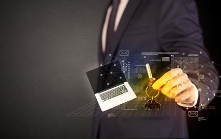 Businessman holding keys with graphs around Banco de Imagens