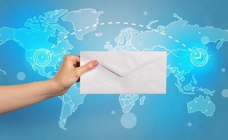 Hand holding envelope with global concept Reklamní fotografie - 114726745