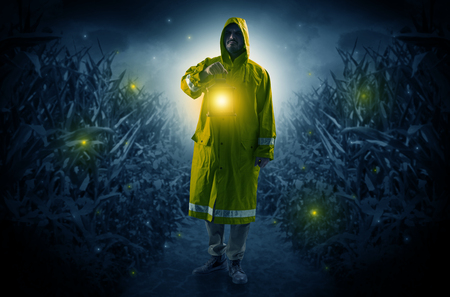 Man coming out from a thicket with lantern Stock Photo