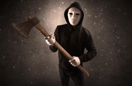 Armed villain in an empty dark room Stock Photo