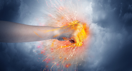 Hand hits intense and makes fire Stock Photo