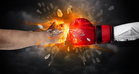 Fighting hands breaking rock