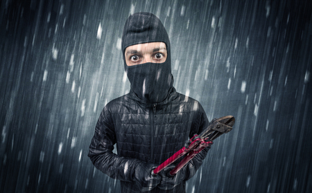 Caught burglar by house camera in action. Stockfoto
