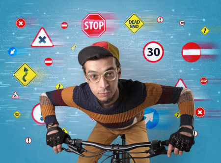 Stylish biker with highway code concept Banco de Imagens