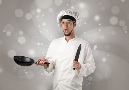 Male cook with shiny grey wallpaper Stok Fotoğraf