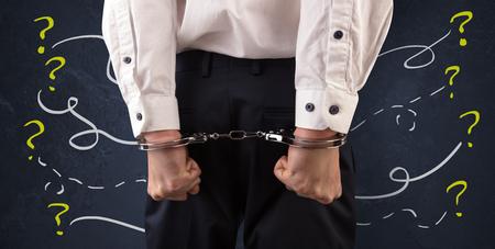 Close prisoner hand with questions around Standard-Bild - 115107440