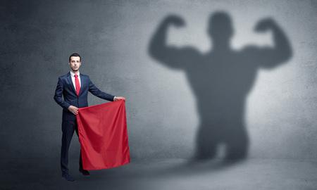 Businessman with strong hero shadow and toreador concept Reklamní fotografie