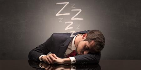 Businessman fell asleep at the office Foto de archivo