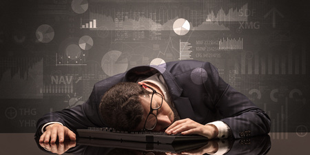 Businessman sleeping with charts, graphs and reports concept Foto de archivo