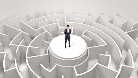 Businessman standing on the top of a maze Banco de Imagens