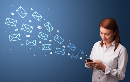 Businesswoman using phone with mail concept around
