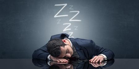Businessman fell asleep at the office