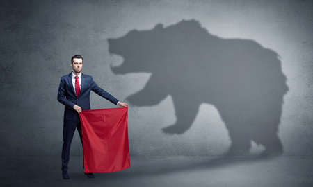 Businessman with bear shadow and toreador concept