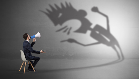 Businessman negotiate with a monster shadow