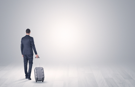 Business with luggage in a boundless space Banco de Imagens