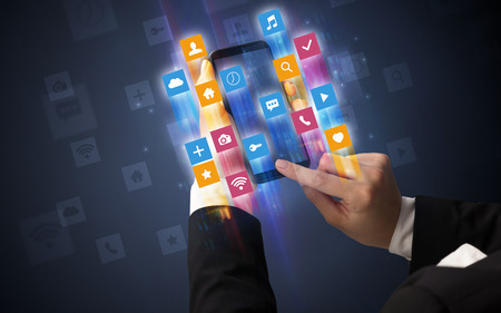 Hand using smartphone with angular app icons Stock Photo