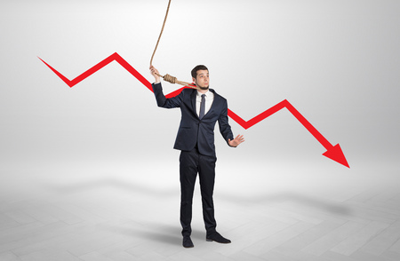 Concept of stressed businessman with arrow declining behind him