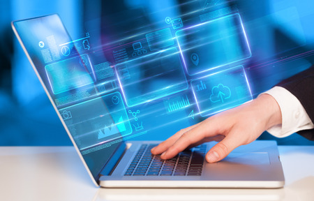 Hand using laptop information database concept Stock Photo