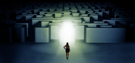 Lost woman standing at illuminated labyrinth entrance