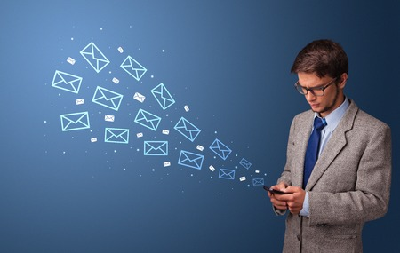Businessman using phone with mail concept around