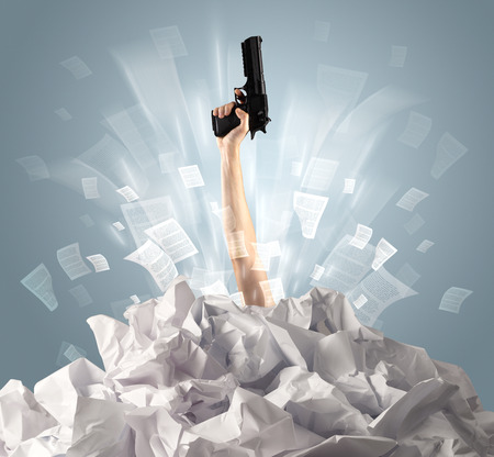 Hand coming out from paper pile Stock Photo - 118214066