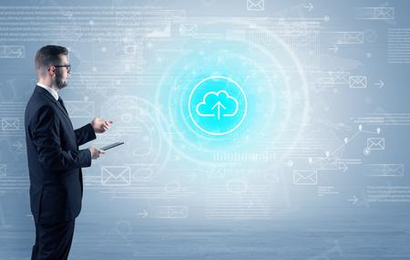 Standing businessman with data around