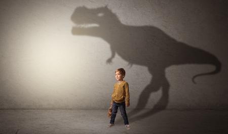 Dinosaurus shadow behind cute boy Stockfoto - 116478592
