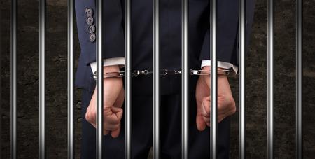 Close handcuffed man in jail Standard-Bild - 116743862