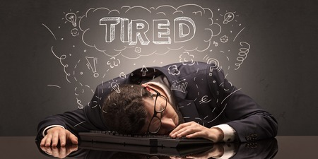 Businessman fell asleep at his workplace with ideas, sleep and tired concept Foto de archivo