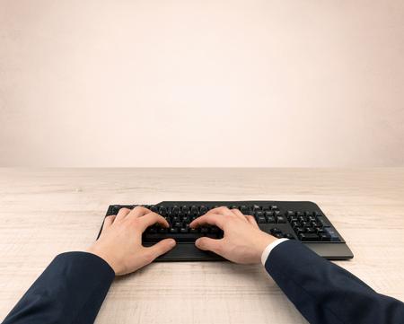 Elegant businessman hand typing on light background