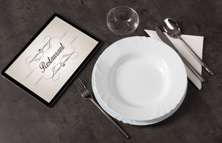Elegant laid table with stylish restaurant logo