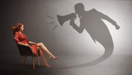 Dark shadow yelling to elegant lady