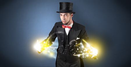 Magician holding his power on his hand Stock Photo