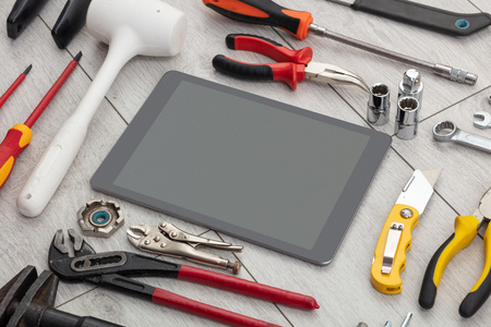 Household tools and tablet with empty screen Stok Fotoğraf