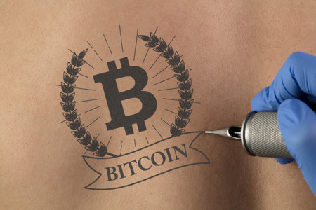 Tattooing cryptocurrency concept on naked back