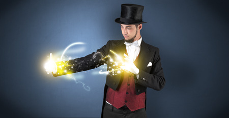Magician holding his power on his hand Standard-Bild - 118201525