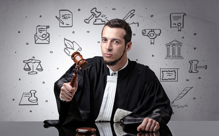 Young judge with court symbols around