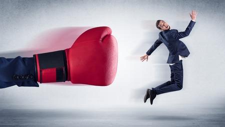 Big hand boxing little businessman 免版税图像