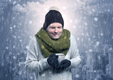 Boy freezing in cold weather with city concept Reklamní fotografie