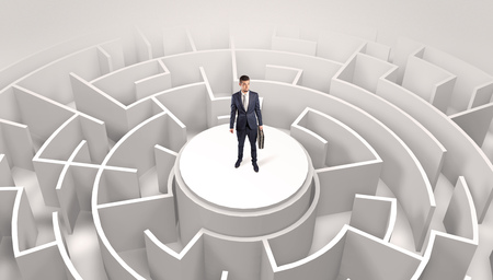 Businessman standing on the top of a maze 写真素材