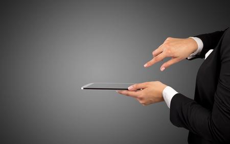 Mockup female hand holding tablet Banco de Imagens