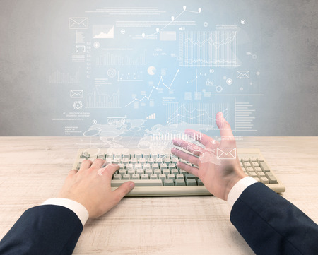 Male hand in a business suit typing financials concept